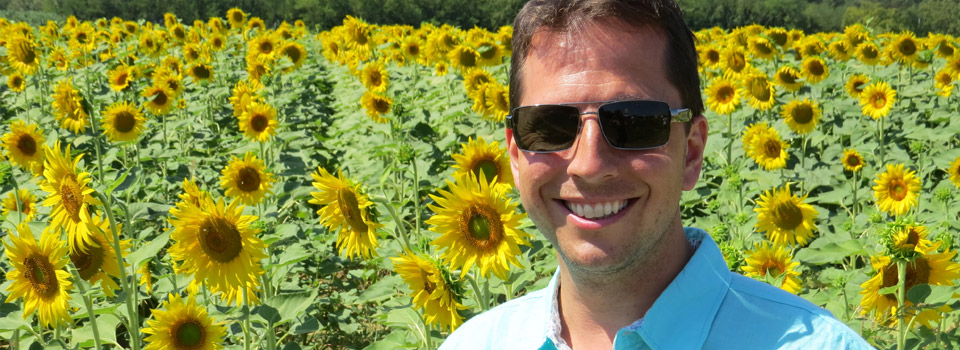 man in sunglasses surround by flowers, - Eye Doctor - Austin & Round Rock, TX